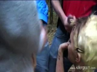 Blonde Girl Vs A Group Of Guys Outdoor In The Forest