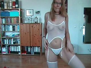 Amateur Girl With Glasses Stripteases And Swallows
