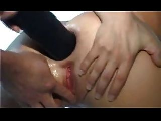 Girl Puts Huge Toy In Her Asshole And Squirting